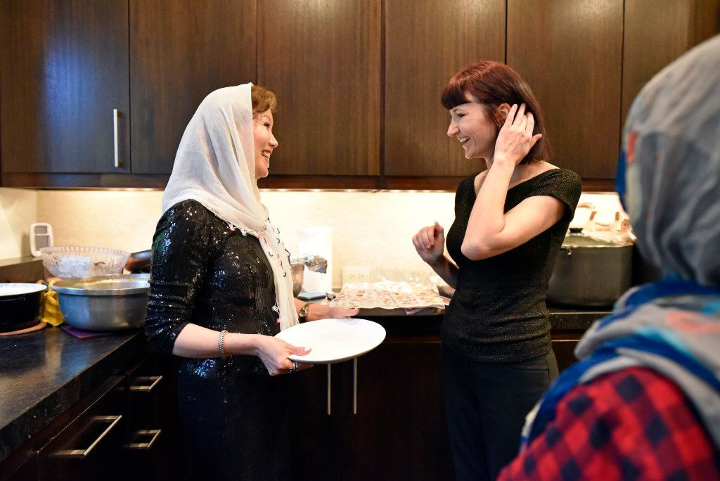 Jamileh Jafari, left, speaks with Olga Pope after preparing an Afghan style dinner for the Sunday Supper Series.