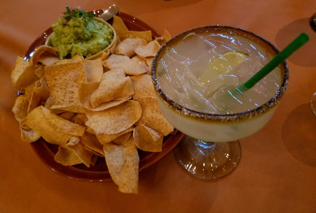 In La Plazuela restaurant at La Fonda Santa Fe, the Centenario Margarita, combining Centenario Tequila with Grand Marnier, Patron Citronge, a splash of Presidente Brandy and a healthy pour of lime and lemon juice, pairs perfectly with a delicious, buttery guacamole.
