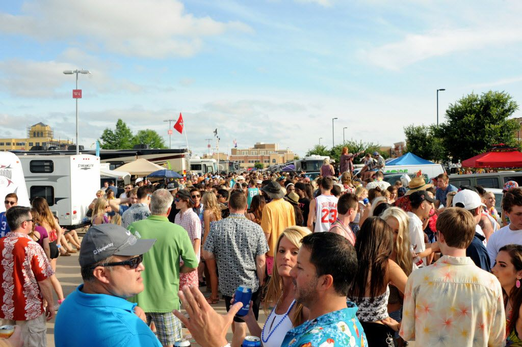 Fans tailgate before the Jimmy Buffett concert at Toyota Stadium in Frisco, TX on May 30, 2015.