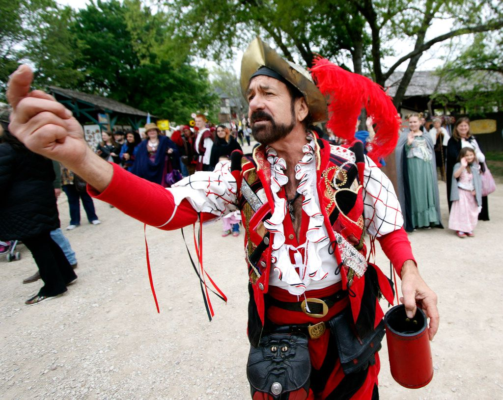 Douglas Kondziolka, a.k.a. Miguel of the Don Juan and Miguel Show, uses his caboose position in the parade to his advantage as he announces and directs visitors to the stage where he and his partner had an upcoming show. The pair have been performing in the festival for the past 34 years.
