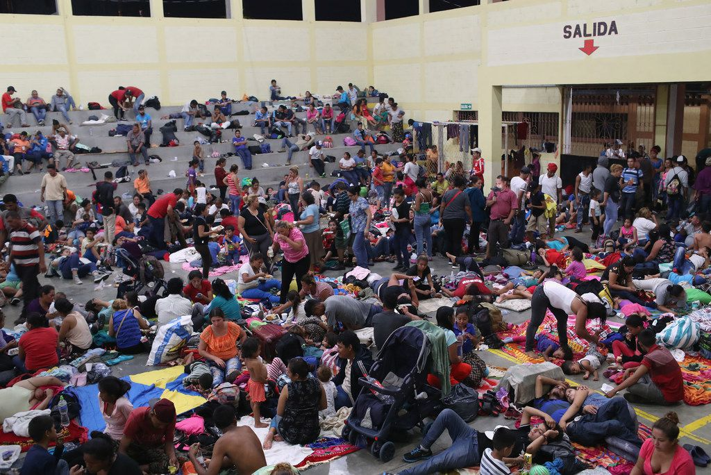 Immigrants, part of the Honduras  migrant caravan of more than 1,500 people, rest for the night in a community gym on October 16, 2018 in Chiquimula, Guatemala.