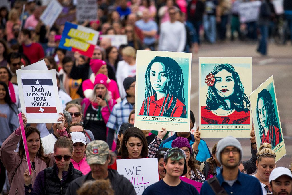 Demonstrators march along Canton Street during the Dallas Women's March on Saturday.