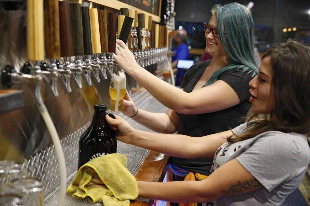 Beertenders, Hannah Riggert (left) and Alexis Massie serve beer at Little Elm Crafthouse in Little Elm.
