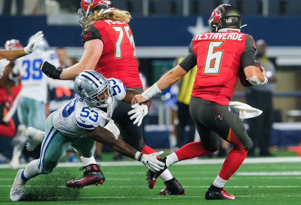 Dallas Cowboys linebacker Justin March-Lillard (53) sacks Tampa Bay Buccaneers quarterback  Vincent Testaverde (6) during the fourth quarter of an NFL preseason football game at AT&T Stadium on Thursday, Aug. 29, 2019, in Arlington.