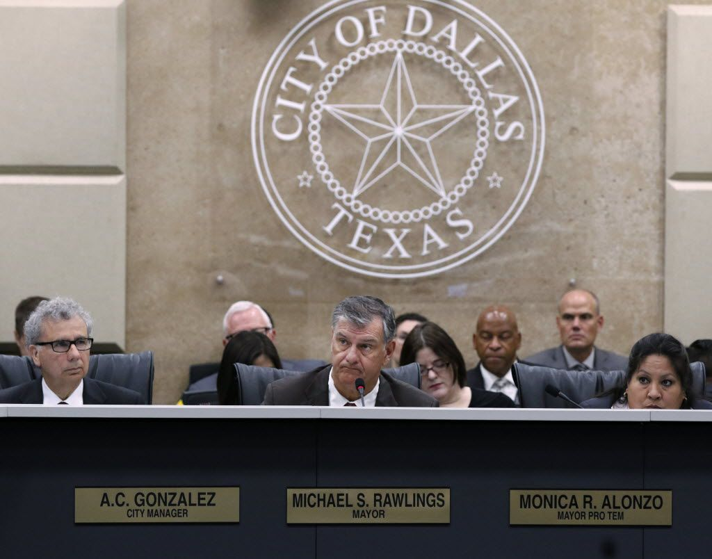 Mayor Mike Rawlings and other city leaders must decide on hiring more Dallas police and raising their wages under the cloud of a decades-old lawsuit on police and firefighter pay. (David Woo/Staff Photographer)