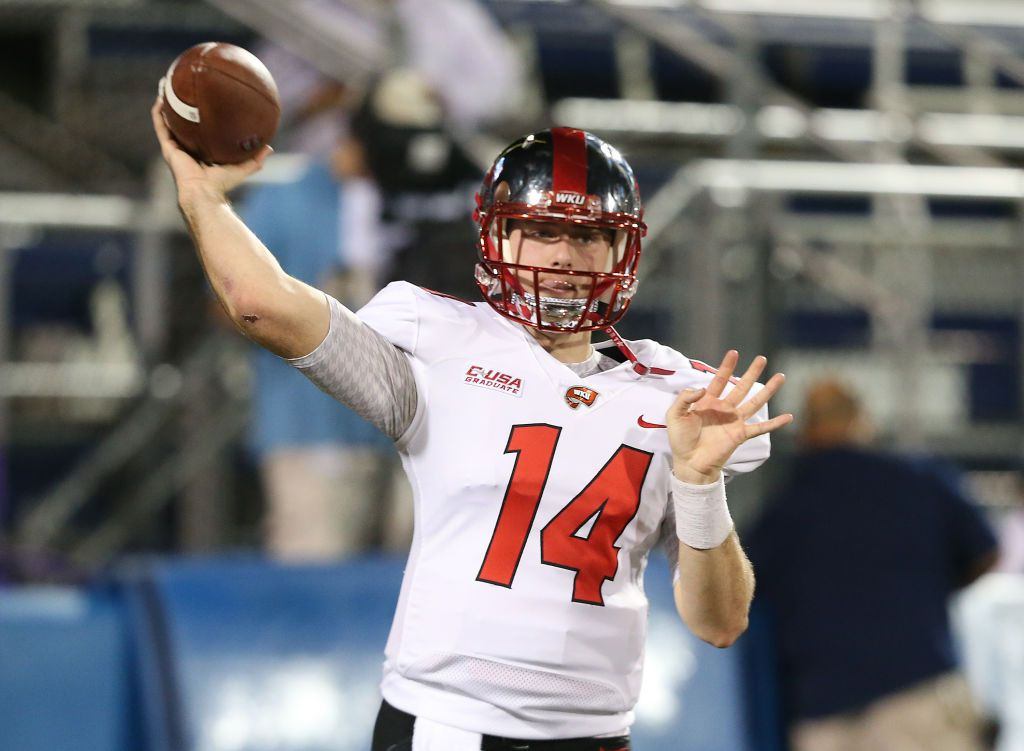 MIAMI, FL - NOVEMBER 24: Mike White #14 of the Western Kentucky Hilltoppers throws the ball prior to the game against the Florida International Golden Panthers on November 24, 2017 at Riccardo Silva Stadium in Miami, Florida. (Photo by Joel Auerbach/Getty Images)