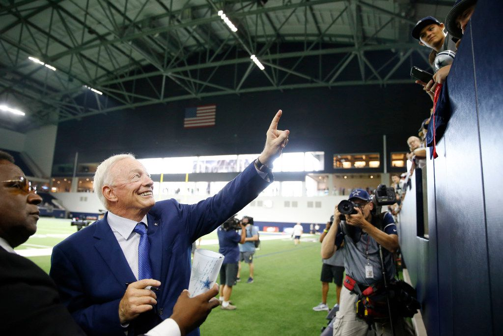 Dallas Cowboys owner and general manager Jerry Jones poses for a fan before practice in the Ford Center during training camp at The Star in Frisco on Monday, August 21, 2017. (Vernon Bryant/The Dallas Morning News)