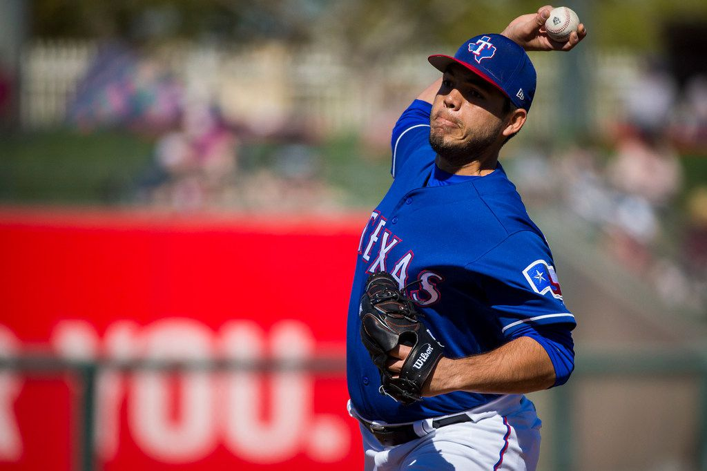 Texas Rangers pitcher Ricky Rodriguez pitches during the third inning of a spring training baseball game against the Colorado Rockies on Sunday, Feb. 25, 2018, in Surprise, Ariz. (Smiley N. Pool/The Dallas Morning News)
