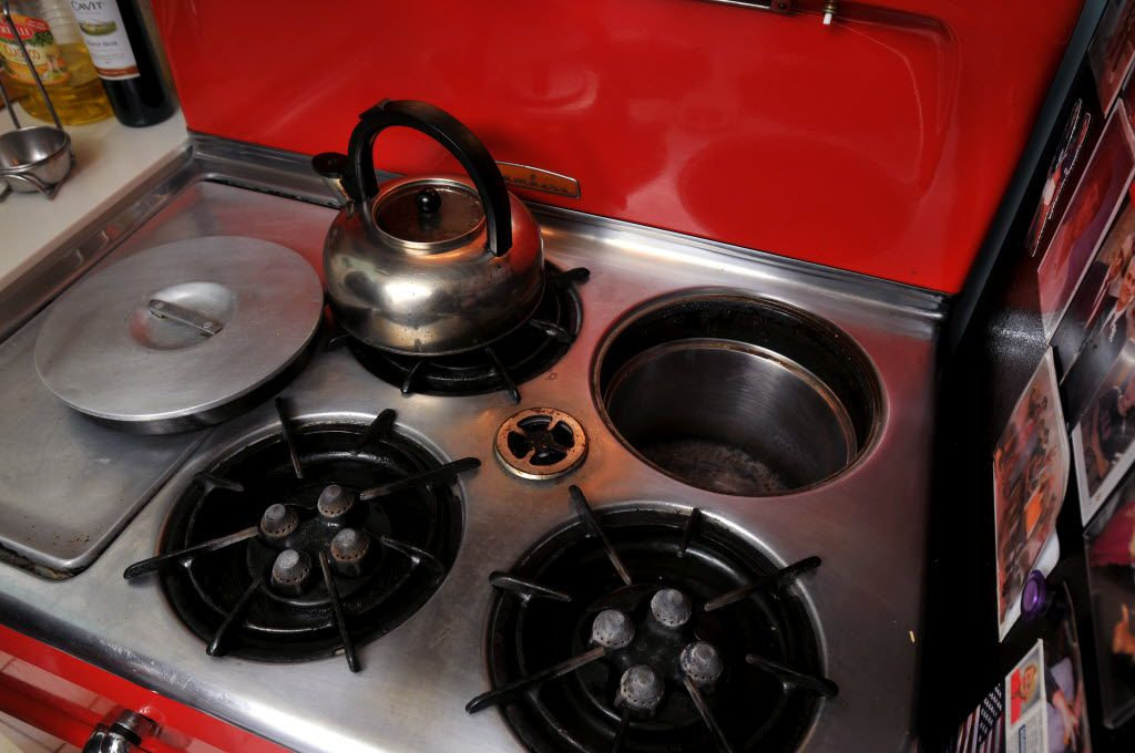 Van and Elsa Moushegian's 1950s-era Chambers stove features a deep-well slow cooker at their home.
