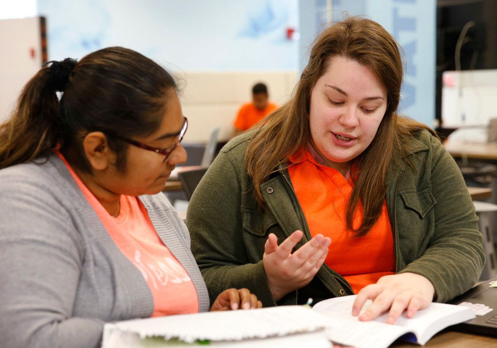 Crystal Ramirez (left), a TCC transfer gets help from peer educator, Baleigh Zurn, a Kilgore College transfer at the I.D.E.A.S. center inside Central Library at the University of Texas at Arlington in Arlington, Texas on Monday, April 29, 2019. UTA is a couple of years into a multi-million grant aimed at helping transfer students reach the finish line. The university's I.D.E.A.S. Center is designed with transfer students and other non-traditional students to help them through mentoring and tutoring as well as other services. (Vernon Bryant/The Dallas Morning News)