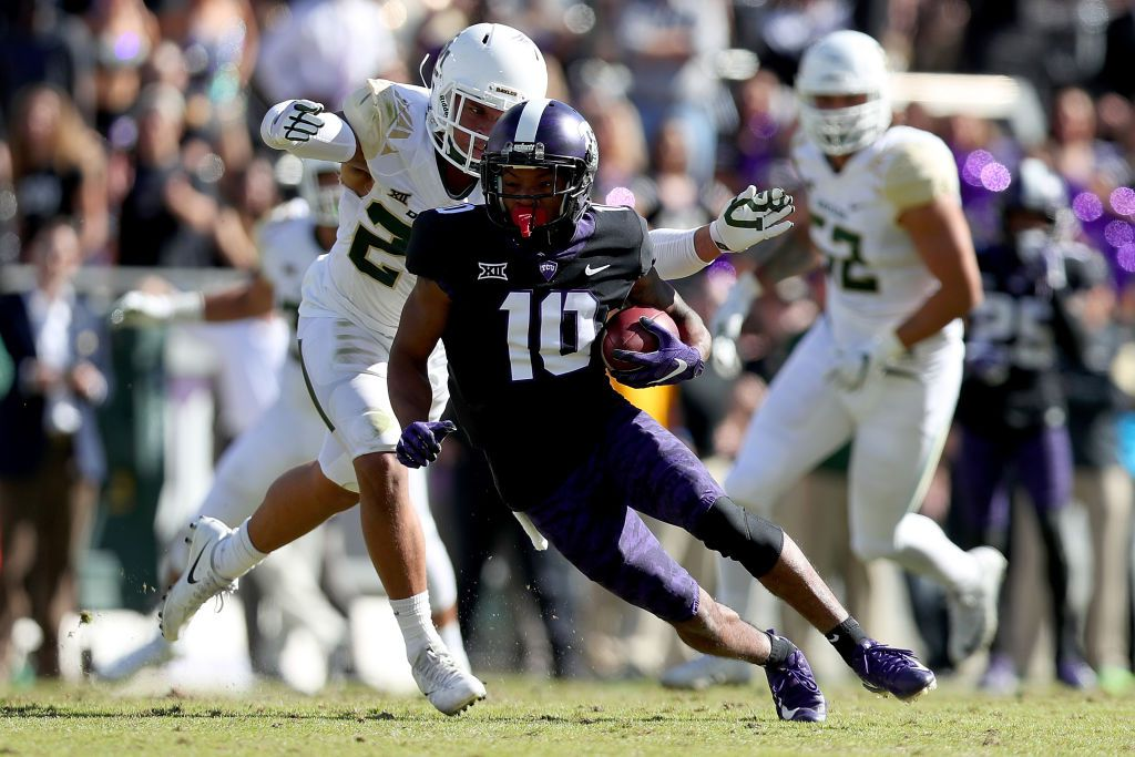 FORT WORTH, TX - NOVEMBER 24:  Desmon White #10 of the TCU Horned Frogs carries the ball against Jalen Pitre #24 of the Baylor Bears in the first half at Amon G. Carter Stadium on November 24, 2017 in Fort Worth, Texas.  (Photo by Tom Pennington/Getty Images)