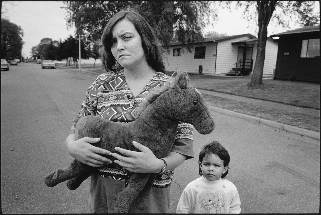 "Tiny holding ""Horsey"" with Keanna, Seattle, 1993, photograph by Mary Ellen Mark"
