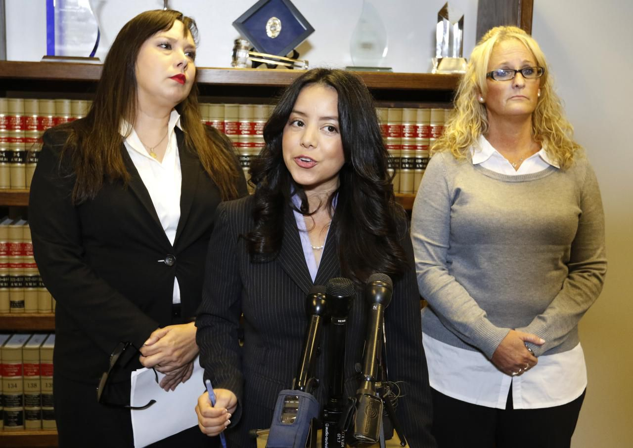 """Maribeth Thomas (right) stood with her attorneys, Victoria Neave (center) and Debbie Sanchez during a news conference on Friday. """"We don't want another teacher to be concerned about bringing issues forward,"""" Neave said."""