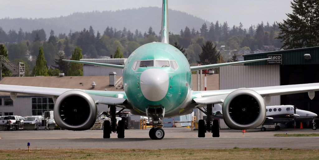 FILE - In this may 8, 2019 photo, a Boeing 737 MAX 8, being built for American Airlines, makes a turn on the runway as it's readied for takeoff on a test flight in Renton, Wash.  Two key lawmakers said Friday, June 7, 2019,  that Boeing planned to delay fixing a nonworking safety alert on its 737 Max aircraft for three years and sped up the process only after the first of two deadly crashes involving Max planes last October. U.S. Reps. Peter DeFazio of Oregon and Rick Larsen of Washington disclosed the decision in letters sent to Boeing and the Federal Aviation Administration seeking details on what the plane maker and the agency knew and when, and at what point airlines were told of the defect.   (AP Photo/Elaine Thompson)