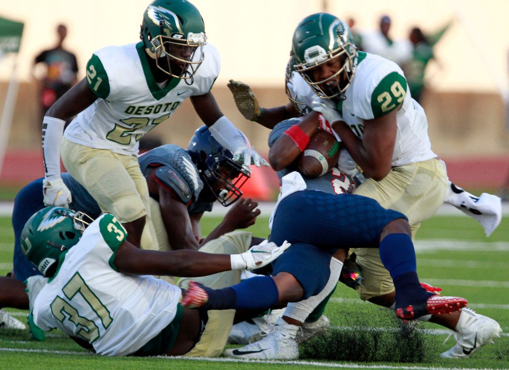 Bishop Dune RB Greg Lane (28) is twisted and tackled by several Desoto defenders, including Jaylen Roberson (37), Tylan Dangerfield (21) and Wanya Duncan (29) during the first half of their high school football game, the Lone Star Sports Football Classic, at Sprague Stadium in Dallas on Saturday, September 14, 2019. (John F. Rhodes / Special Contributor)