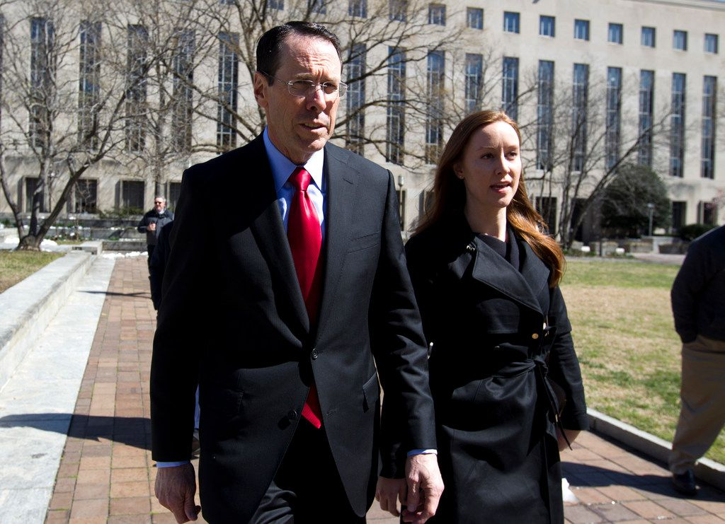 AT&T CEO Randall Stephenson leaves the federal courthouse Thursday, March 22, 2018, in Washington. The Trump administration is facing off against AT&T to block the telephone giant from absorbing Time Warner, in a case that could shape how consumers get, and how much they pay for, streaming TV and movies.
