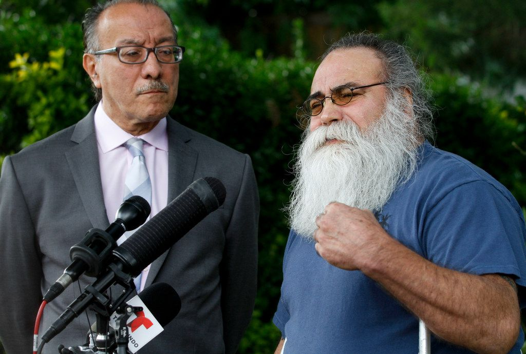 Juan Moreno Sr ( right) and Carlos Quintanilla speak to the media outside the Moreno home in Farmers Branch on Thursday, June 27, 2019. Moreno's son, Juan Moreno, was shot and killed by a Farmers Branch police officer who  has been indicted for murder in the shooting.