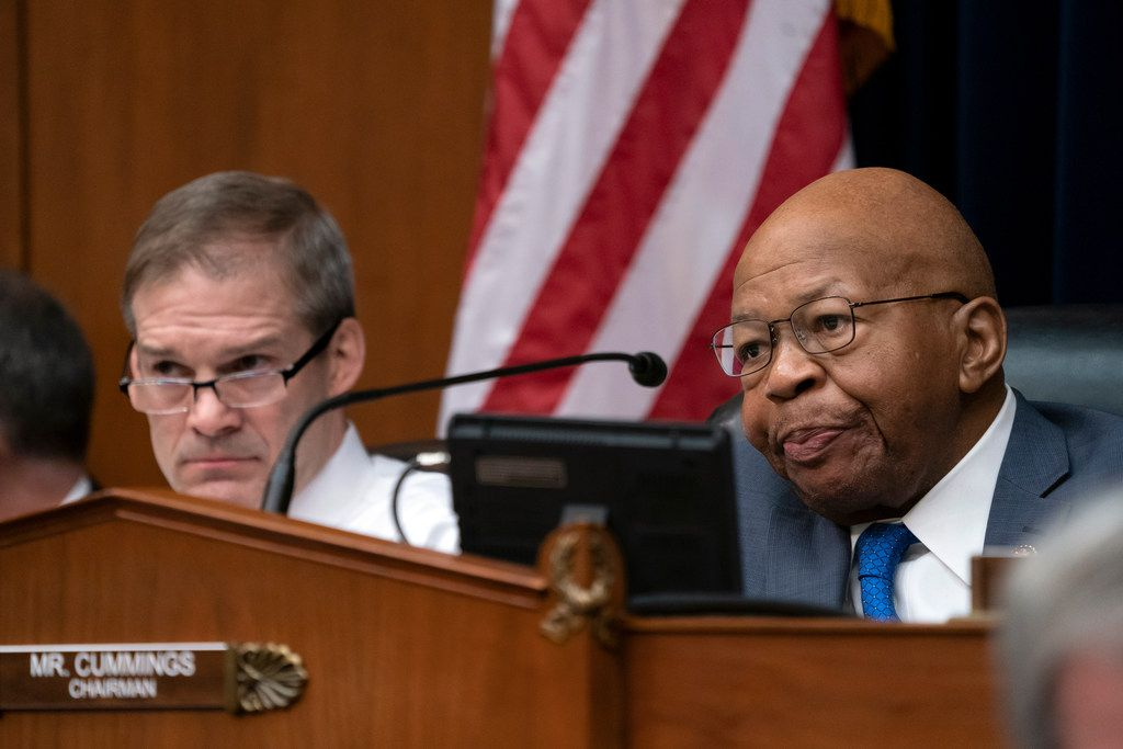 House Oversight and Reform Committee Chair Elijah Cummings, D-Md., is joined at left by Rep. Jim Jordan, R-Ohio, ranking member, as Michael Cohen, President Donald Trump's former personal lawyer, testifies on Capitol Hill in Washington, Wednesday, Feb. 27, 2019. (AP Photo/J. Scott Applewhite)