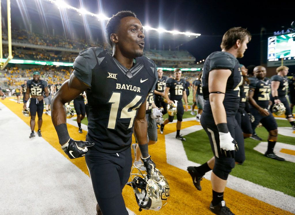 FILE - Baylor wide receiver Chris Platt (14) and other players walk off the fields after a 35-24 win over Oklahoma State at McLane Stadium in Waco, Texas, Saturday, Sept. 24, 2016. (Jae S. Lee/The Dallas Morning News)