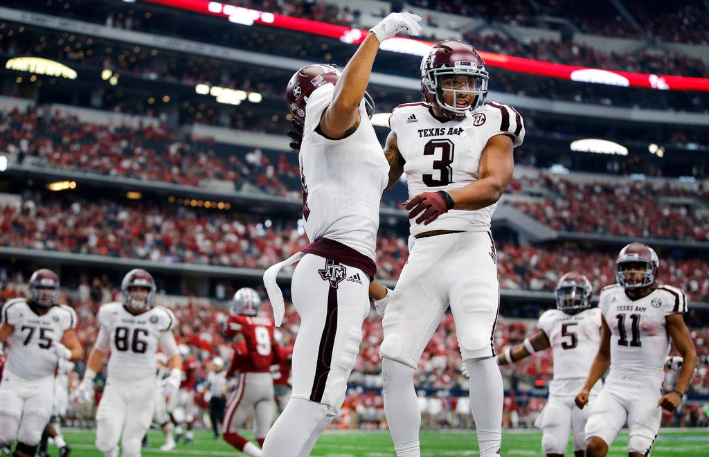 Texas A&M Aggies wide receiver Christian Kirk (3) is congratulated on his fourth quarter touchdown against the Arkansas Razorbacks by teammate Christian Kirk (3) at AT&T Stadium in Arlington, Saturday, September 23 2017. The Aggies won in overtime, 50-43. (Tom Fox/The Dallas Morning News)