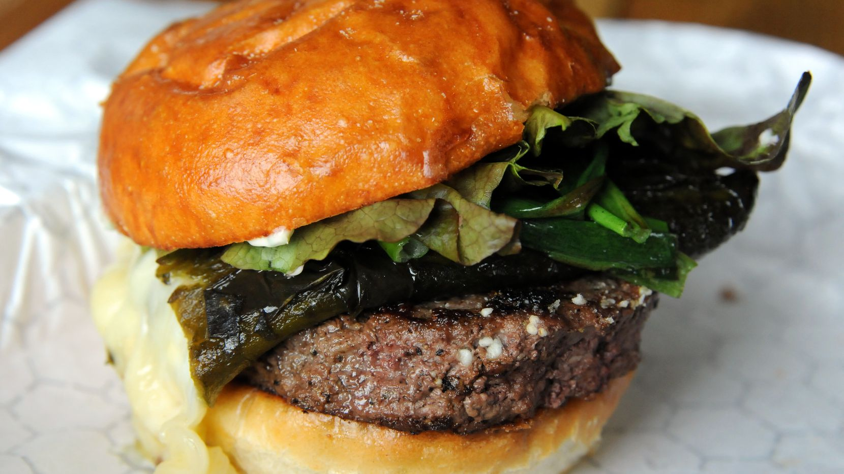 The poblano burger features grilled poblano, queso oaxaca, green onions and cilantro mayo at Thurber Mingus in Fort Worth.