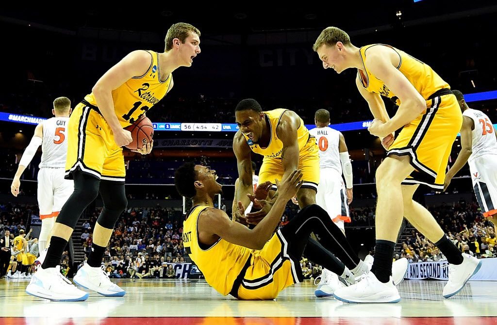 CHARLOTTE, NC - MARCH 16:  Jourdan Grant #5 and teammate Arkel Lamar #33 of the UMBC Retrievers react after a score against the Virginia Cavaliers during the first round of the 2018 NCAA Men's Basketball Tournament at Spectrum Center on March 16, 2018 in Charlotte, North Carolina.  (Photo by Streeter Lecka/Getty Images)