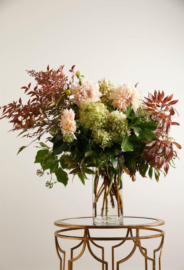 Floral arrangement including pistachio leaves, nandina leaves, bush ivy, Cafe au lait Pee Gee dahlia and hydrangeas photographed at Avant Garden