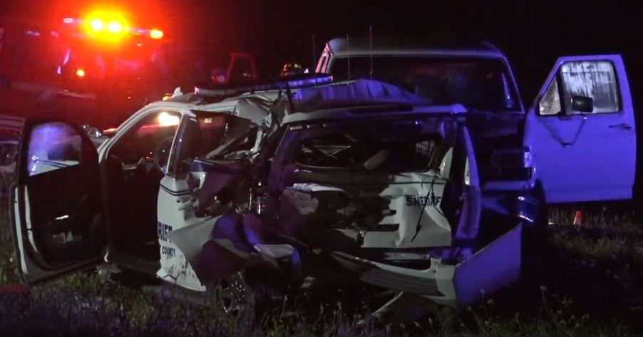A Tarrant County Sheriff's Department vehicle was mangled in a wreck Friday morning when a truck rear-ended it on Jacksboro Highway. A deputy was injured and hospitalized after the crash.