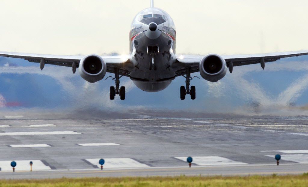 (FILES) This September 23, 2013 file photo shows an American Airlines Boeing 737 airplane as it takes off from a runway at Ronald Reagan Washington National Airport in Arlington, Virginia.  US aerospace giant Boeing on January 6, 2015 reported a banner year in 2014 for commercial aircraft, breaking records for new orders and deliveries. Boeing said it booked 1,432 net orders for commercial aircraft last year, with a list price value of $232.7 billion, topping its 2007 previous record. The company's backlog of unfilled orders climbed to 5,789, also an all-time high. For the second year in a row, the company said it had delivered a record number of airliners, at 723, as it stepped up production rates. AFP PHOTO / Saul LOEBSAUL LOEB/AFP/Getty Images 03042015xBIZ