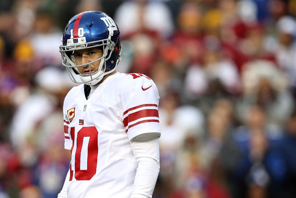 LANDOVER, MD - JANUARY 01: Quarterback Eli Manning (#10) of the New York Giants looks on during the first quarter of a game against the Washington Redskins at FedExField on January 1, 2017, in Landover, Maryland. (Photo by Patrick Smith/Getty Images)