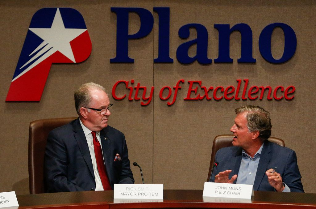 Plano Mayor Pro Tem Rick Smith (left) listened Monday night as Planning and Zoning Commission Chair John Muns explained why his group didn't have sufficient information to take a vote on changing the city's master development plan.