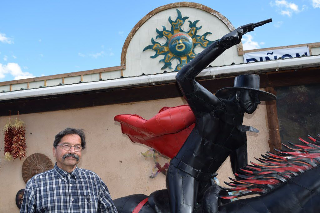 Glencoe Fruit Stand owner Monroy Montes installed a life-sized statue of Texas Tech's Masked Rider to appeal to his Texas customers.