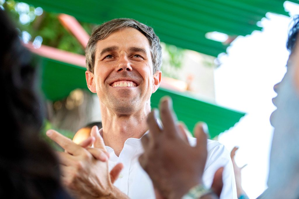 Rep. Beto O'Rourke, a Democrat looking to unseat incumbent Sen. Ted Cruz, cheered as he listened to Dallas County Judge Clay Jenkins at a rally in Dallas in May.