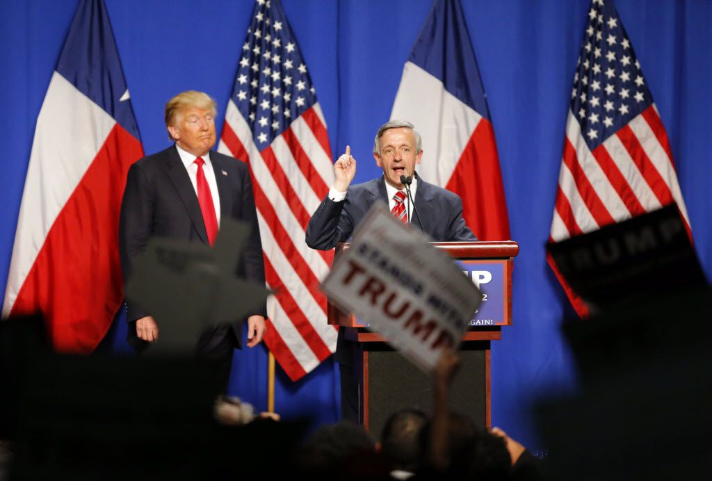 First Baptist Church's Dr. Robert Jeffress speaks on behalf of Republican presidential candidate Donald Trump (left) during a rally at the Fort Worth Convention Center in downtown Fort Worth on Feb. 26, 2016.