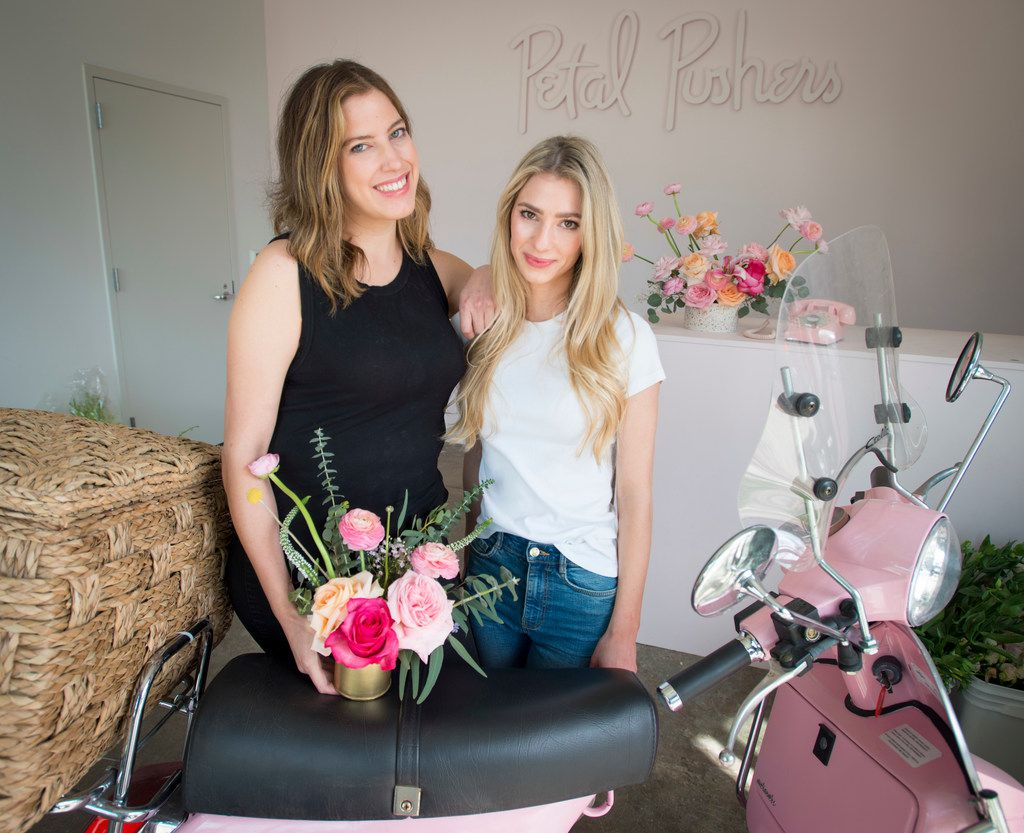 For orders within the Dallas city limits, Giselle Ruggeberg (left) and Ali Pickens send their flowers out for delivery on a pink Vespa.
