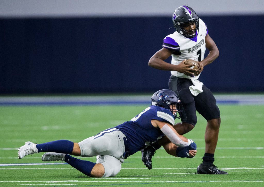 Frisco Independence quarterback Braylon Braxton (1) is tackled by Frisco Independence linebacker Alessio Russolillo (33) during the first quarter of a District 5-5A Division I high school football game between Frisco Independence and Frisco Lone Star on Thursday, October 10, 2019 at the Ford Center at The Star in Frisco. (Ashley Landis/The Dallas Morning News)