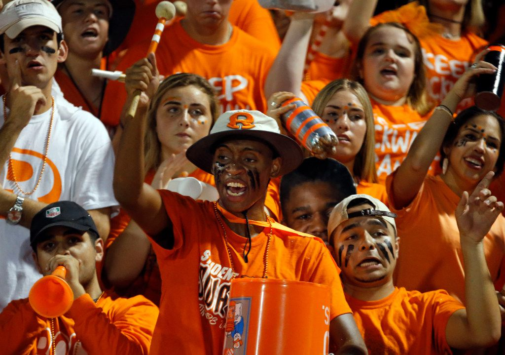 Rockwall fan Jarrod Winston, with drumstick) and the rest of the student section celebrate a Rockwall TD during the first half of a high school football game against Heath High on Friday, September 23, 2016.  (John F. Rhodes / Special Contributor)
