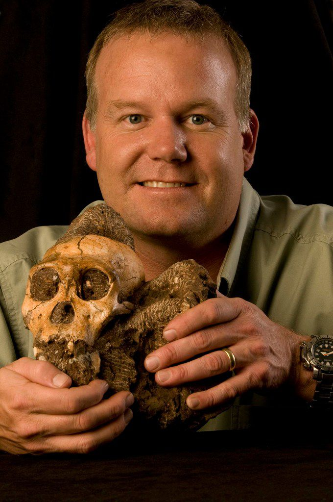 Wits University's Rising Star Expedition leader, Lee Berger, holds the fossil of an Australopithecus sediba individual.