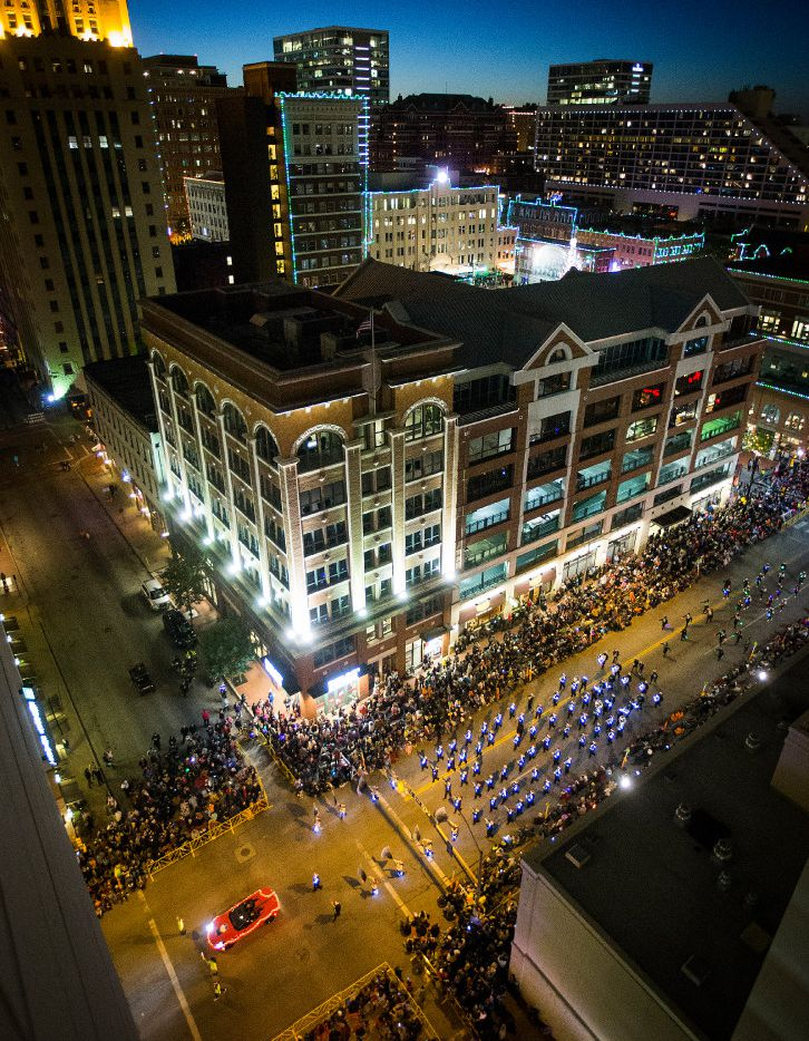 The Trimble Tech High School Band marches along Commerce Street during the XTO Energy 2016 Parade of Lights in Fort Worth