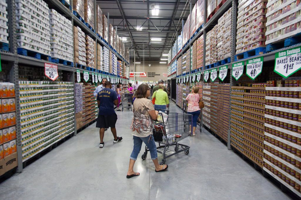 Shoppers push their shopping carts and walk down the aisles inside the new WinCo grocery store. The new store is 85,000 sqaure-foot and will be open 24 hours, Thursday, July 28, 2016, in Denton, Texas. Jeff Woo/DRC