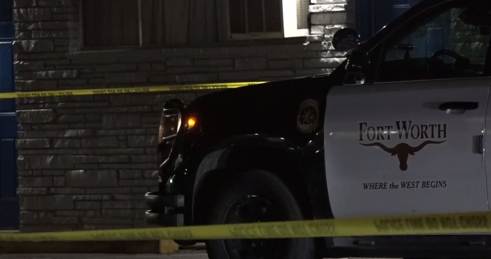 A Fort Worth police vehicle sits outside a motel where a body was discovered in a bathtub Tuesday night.