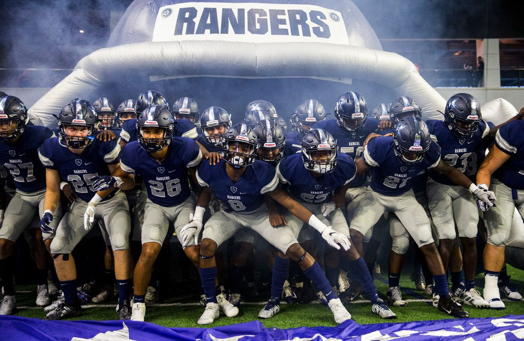 Frisco Lone Star football players prepare to run on the field before a District 5-5A Division I high school football game between Frisco Independence and Frisco Lone Star on Thursday, October 10, 2019 at the Ford Center at The Star in Frisco. (Ashley Landis/The Dallas Morning News)