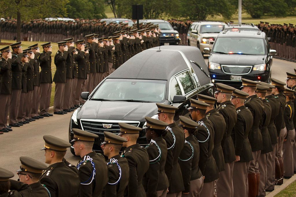 The hearse carrying former first lady Barbara Bush passes through members of the Texas A&M Corps of Cadets as it nears her husband's presidential library at the university on Saturday, April 21, 2018, in College Station, Texas. After an invitation-only funeral in Houston, Bush, who died on Tuesday, was buried at a gated plot near the library. 700 members of the Corps of Cadets lined the Barbara Bush Drive leading up to the library.