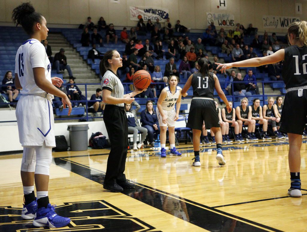 Head referee Kelly Murray, left, officiates a district 6-6A basketball game between Flower Mound and Plano West, during the first half on Friday, Jan. 08, 2016 at Plano West High School in Plano. Ben Torres/Special Contributor