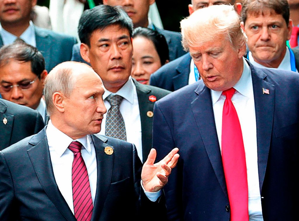 President Donald Trump (right) and Russian President Vladimir Putin talk during a photo session last year. The Democratic National Committee filed a lawsuit against Russia and other parties Friday, claiming their actions interfered in the 2016 presidential election.