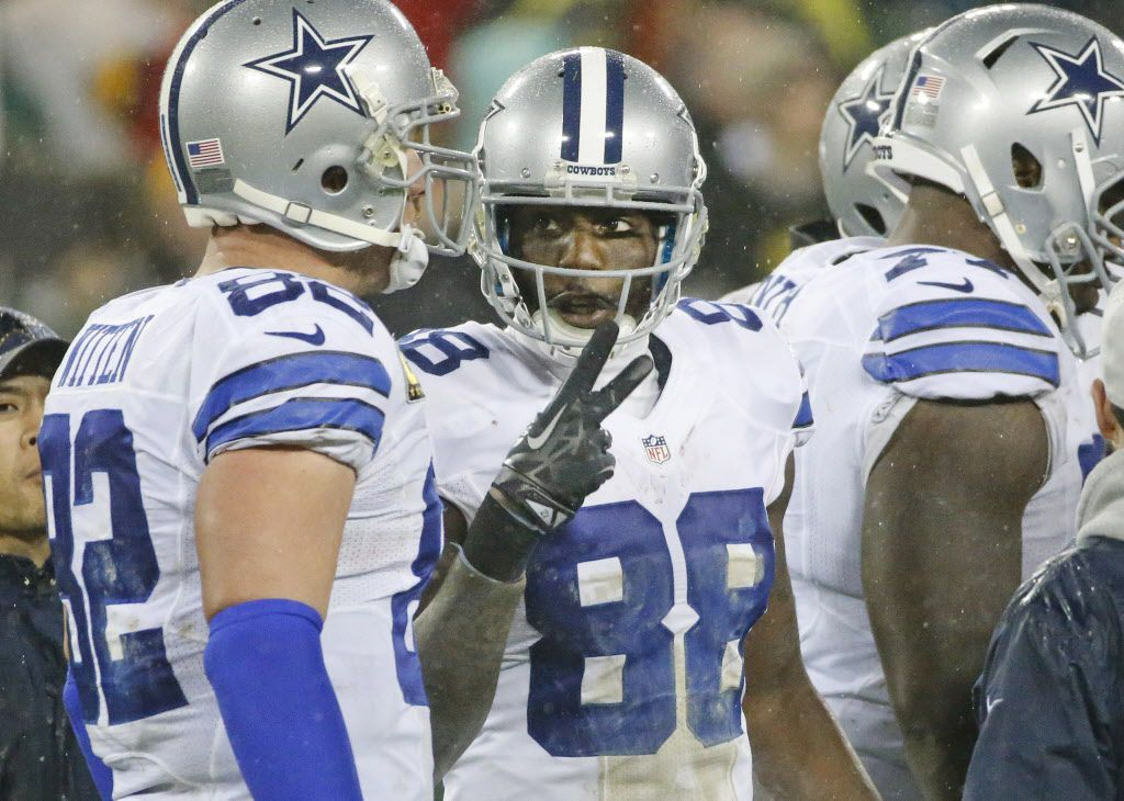 Dallas Cowboys wide receiver Dez Bryant (88) talks with tight end Jason Witten (82) during a time out late in the fourth quarter during the Dallas Cowboys vs. the Green Bay Packers NFL football game at Lambeau Field in Green Bay, Wisconsin on Sunday, December 13, 2015. (Louis DeLuca/The Dallas Morning News)