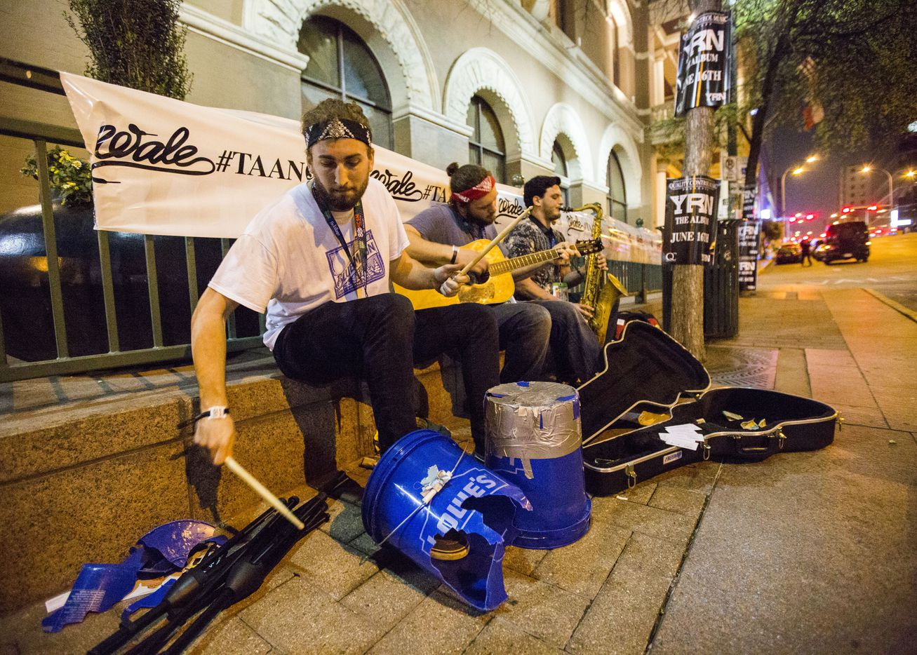 Tyler Matte, Mark Gentile and Julian Jacobson of Chapel Hill, North Carolina perform outside the Driskill Hotel on Sixth Street during the 2015 SXSW music festival on Thursday, March 19, 2015 in downtown Austin, Texas.   (Ashley Landis/The Dallas Morning News)