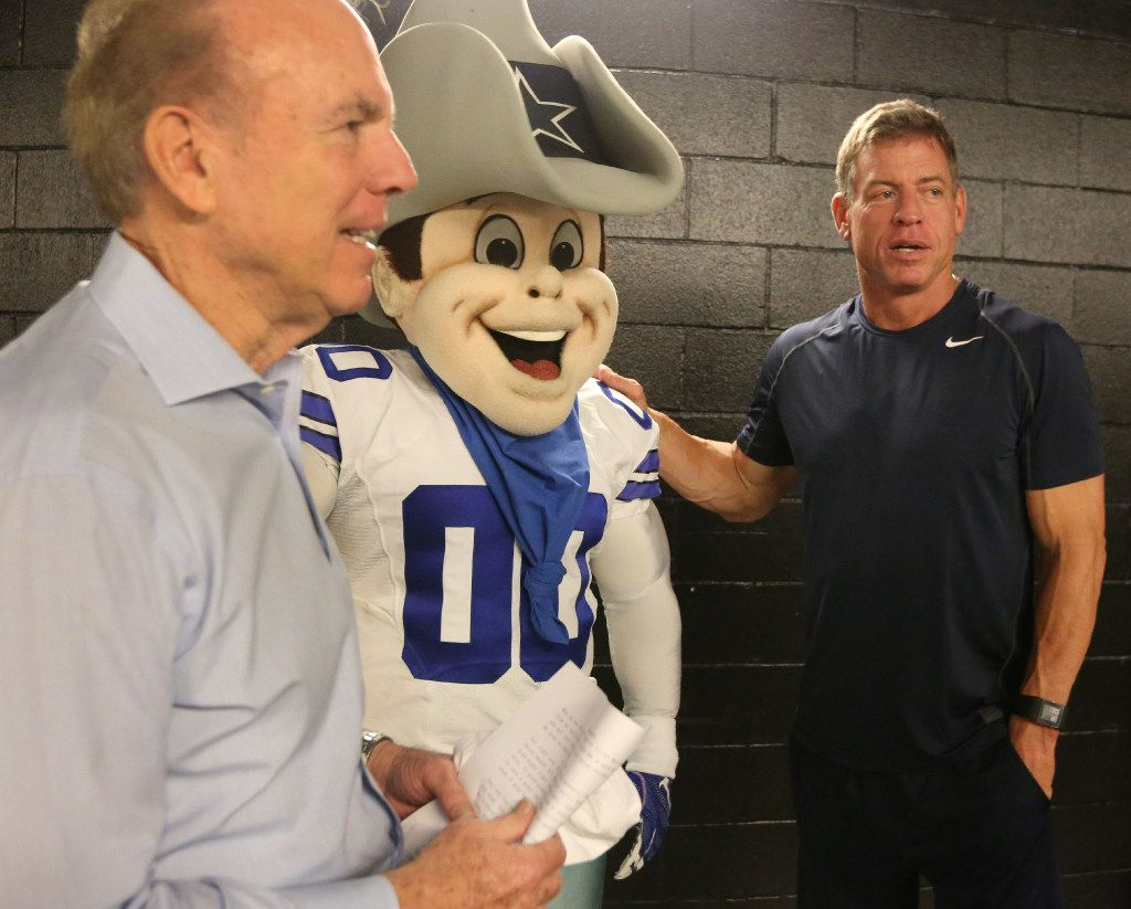 """Roger Staubach, Dallas Cowboys mascot """"Rowdy"""" and Troy Aikman visited during the filming of a public service announcement for United Way of Metropolitan Dallas at American Airlines Center on Aug. 7."""