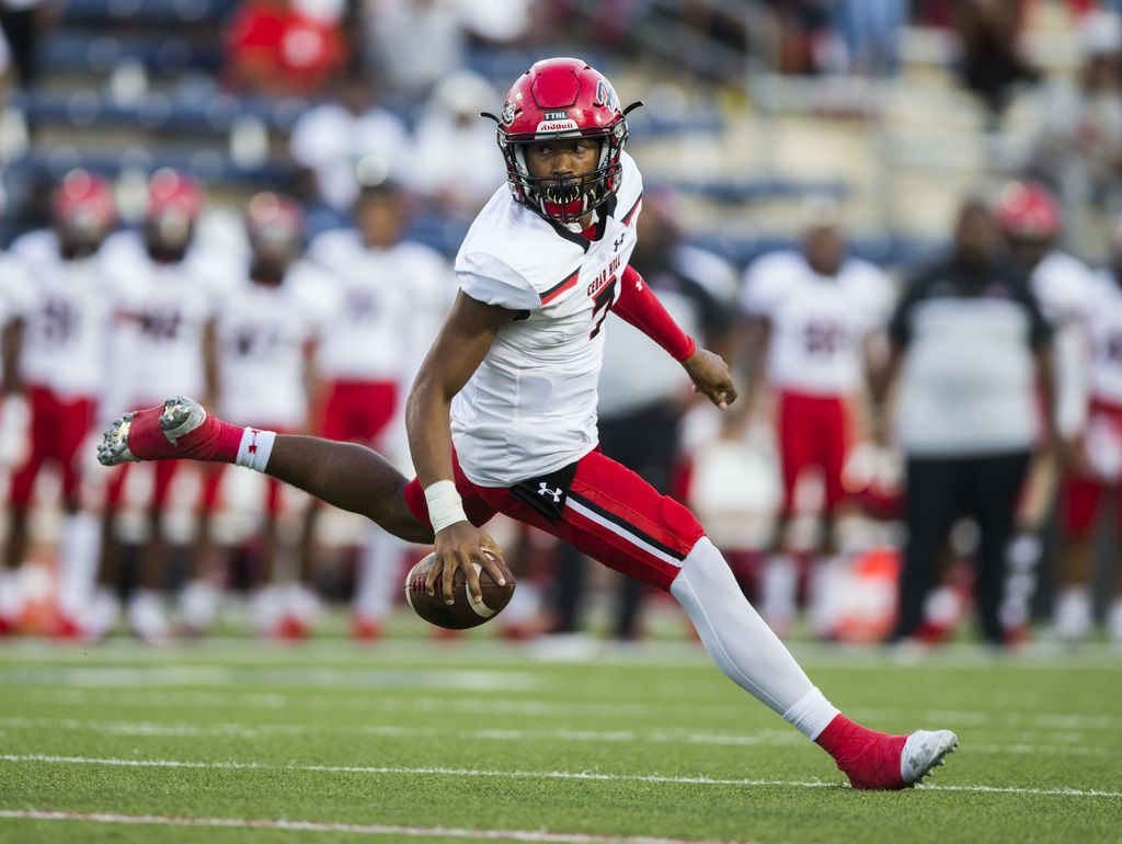 Cedar Hill quarterback Kaidon Salter (7) scrambles during the first quarter of a high school football game between Allen and Cedar Hill on Friday, August 30, 2019 at Eagle Stadium in Allen. (Ashley Landis/The Dallas Morning News)