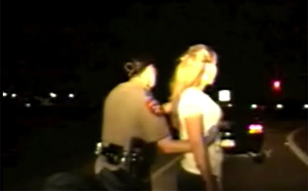 """Texas Department of Public Safety trooper Kelly Helleson frisks a woman during a July 13 traffic stop. The two women searched during the stop have sued Helleson, another trooper and their supervisor claiming that the troopers subjected them to an illegal and humiliating """"roadside body cavity search."""""""